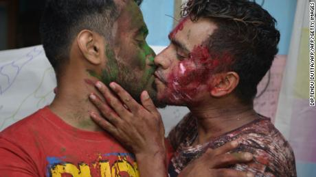 """Two men kiss as members of the LGBT community celebrated the Supreme Court's ruling. """"The law had become a weapon for harassment for the LGBT community,"""" Chief Justice Dipak Misra said as he announced the landmark verdict."""