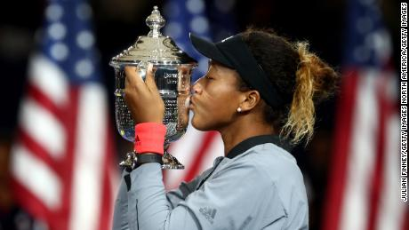 NEW YORK, NY - SEPTEMBER 08:  Naomi Osaka of Japan poses with the championship trophy after winning the Women's Singles finals match against Serena Williams of the United States on Day Thirteen of the 2018 US Open at the USTA Billie Jean King National Tennis Center on September 8, 2018 in the Flushing neighborhood of the Queens borough of New York City.  (Photo by Julian Finney/Getty Images)