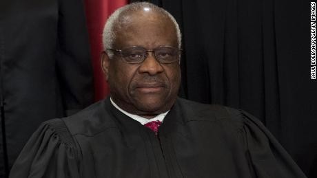 Justice Clarence Thomas sits for an official photo in 2017 with other members of the US Supreme Court.