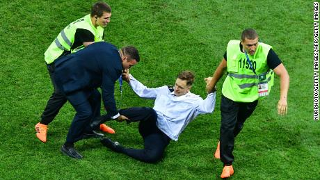 Verzilov is removed from the field of play after protesting at the 2018 World Cup Finals in Moscow.