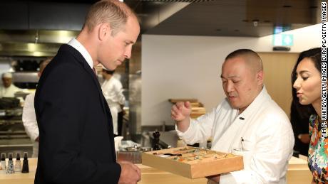 Chef Akira Shimizu presents his signature bento box to Prince William.