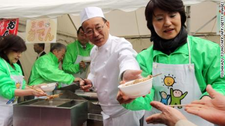 Sadakazu Tanigaki, then-secretary general of Japan's ruling Liberal Democratic Party (LDP) serves bowls of whale meat curry and oden -- a Japanese hot pot dish -- to party members at the LDP headquarters in Tokyo in 2015.