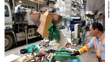 Crews work to remove debris and ruined goods on Monday, after Typhoon Mangkhut devastated Macau one day earlier.