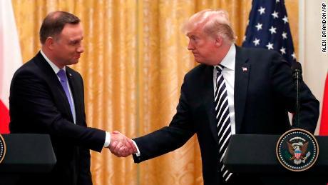 Trump praises Poland a day after EU moves to sue Warsaw
