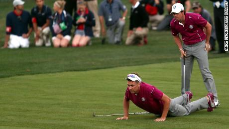 Poulter and McIlroy fighting hard in 2012 Ryder Cup at Medinah.