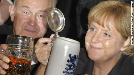 "Bavaria's State Premier Guenther Beckstein toasts with Angela Merkel during the Berlin version ""Oktoberfest"" in 2008"