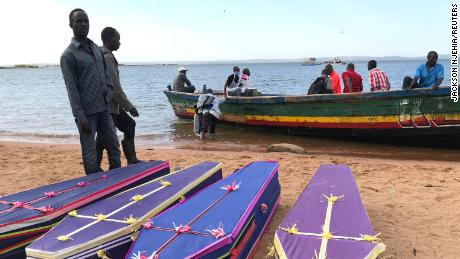 Volunteers arrange the coffins of passengers killed when a ferry capsized in Tanzania.