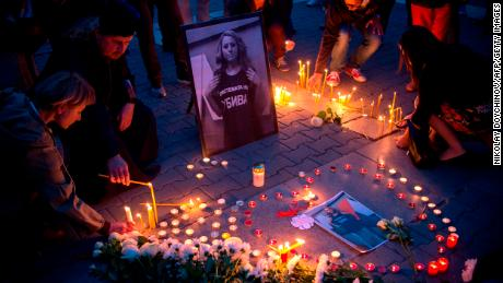 People light candles during a vigil in memory of Viktoria Marinova in the Bulgarian capital, Sofia, on Monday.