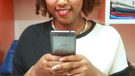 A Tecno user in Ethiopia using her smartphone.