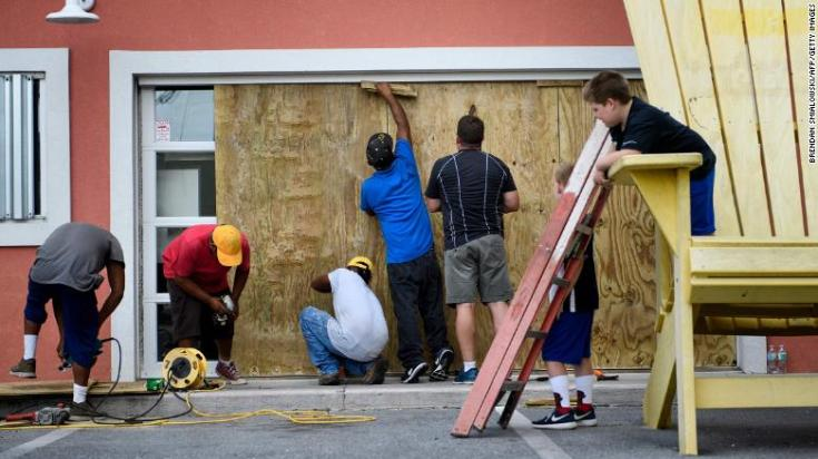 Workers boarded the windows of Marco's Pizza in Panama City Beach , Florida as Hurricane Michael approached Tuesday.