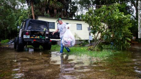 Mitchell Pope tries to salvage what he can from his mobile home Wednesday in St. Marks.