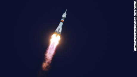 The Soyuz-FG rocket booster blasts off from the Baikonur Cosmodrome carrying the Soyuz MS-10 spacecraft and crew.