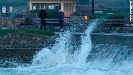 People avoid the waves on Salthill promenade, Co Galway during Storm Callum.