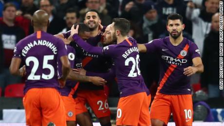 Manchester City celebrate after Mahrez's goal.