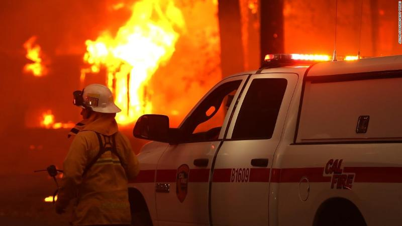 A firefighter monitors a burning home on November 8.