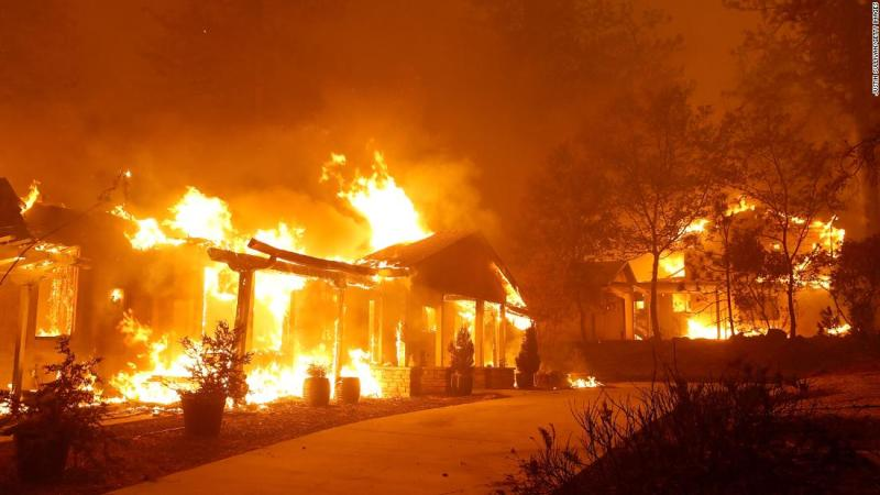 A Paradise home is engulfed in flames on November 8.