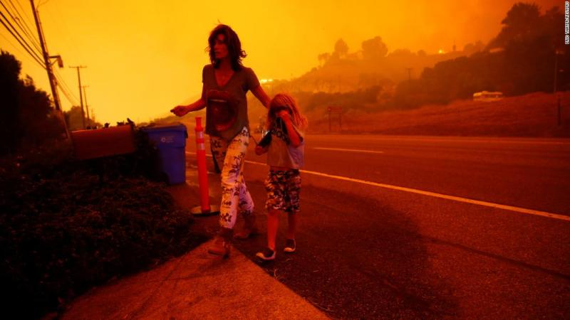 Gabi and Jonah Frank walk on the Pacific Coast Highway as the Woolsey Fire threatens their Malibu home on November 9.