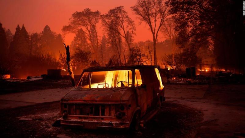 Flames burn inside a van as the Camp Fire tears through Paradise on November 8.