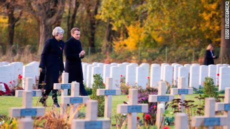 UK Prime Minister Theresa May talks with French President Emmanuel Macron at the Thiepval Memorial in northern France on Friday.