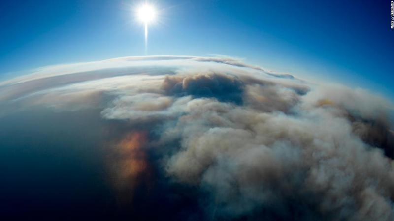 Smoke is seen over the Pacific in this photo taken from a helicopter over Malibu on November 9.