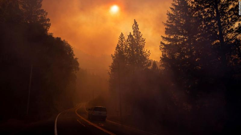 A vehicle drives through smoke on Sunday, November 11, near Pulga.
