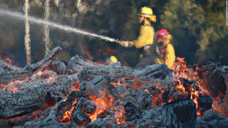 Firefighters work at the Salvation Army Camp on Saturday, November 10, in Malibu.
