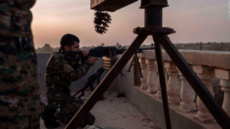 YPG fighters are seen on the frontline on October 18, in Baghoz, Syria, during the Hajin operation to retake the last stronghold of ISIS in Syria.