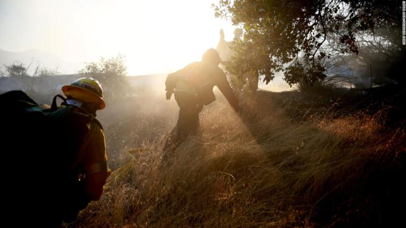 Firefighters battle a blaze in Malibu, California, on Saturday, November 10. The Woolsey Fire has burned more than 91,000 acres and destroyed at least 370 structures.