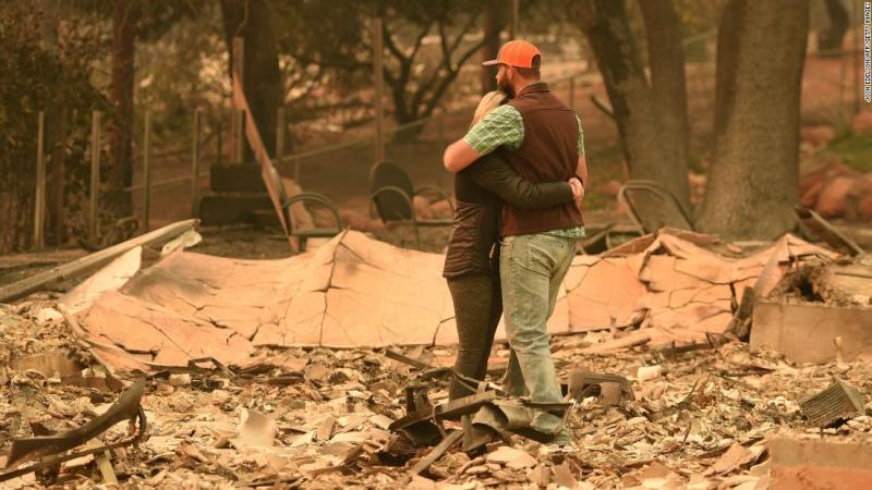 Chris and Nancy Brown embrace while looking over the remains of their home on November 12 after the Camp Fire tore through area.