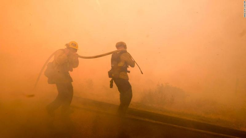 Firefighters battle a fire on November 12 along the Ronald Reagan Freeway in Simi Valley.