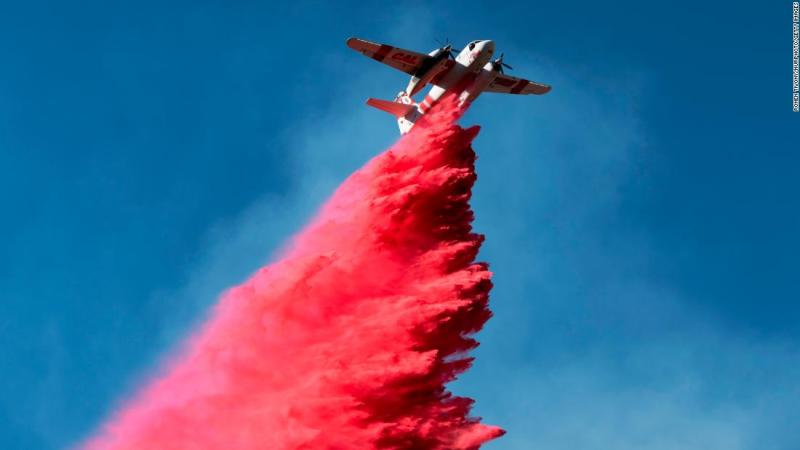 A plane drops fire retardant on November 12 on the Woolsey Fire near Malibu, California.