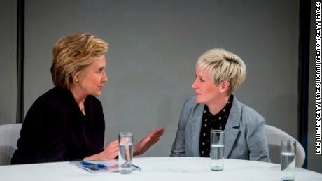 Rapinoe talks to then Democratic presidential candidate Hillary Clinton during a roundtable discussion on pay equality.