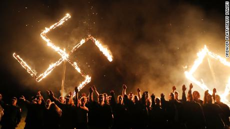 One of the largest neo-Nazi groups in the US had a swastika burning after a rally this April in Draketown, Georgia.