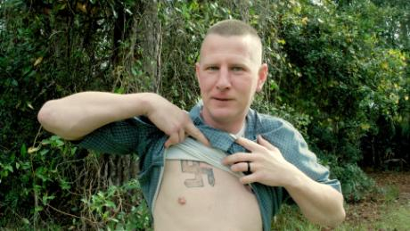 Ken Parker reveals a swastika he had tattooed on his chest when he was involved in the neo-Nazi movement.