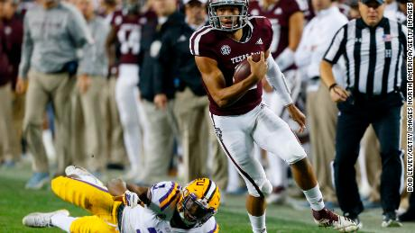 Texas A&M quarterback Kellen Mond slips the tackle attempt by LSU's JaCoby Stevens in the first half.