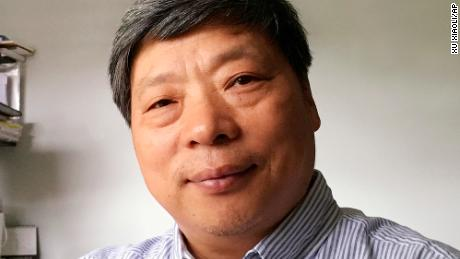The wife of the award-winning Chinese photographer says he was taken away by authorities in Xinjiang.