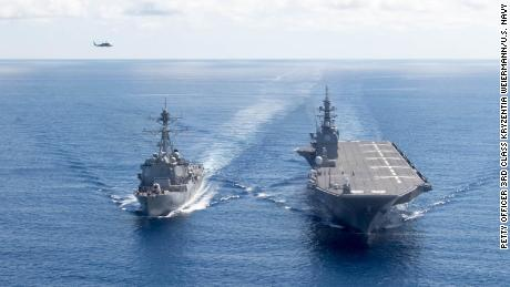 The Japan Maritime Self-Defense Force ship JS Izumo sails the South China Sea with the US guided-missile destroyer USS Dewey.