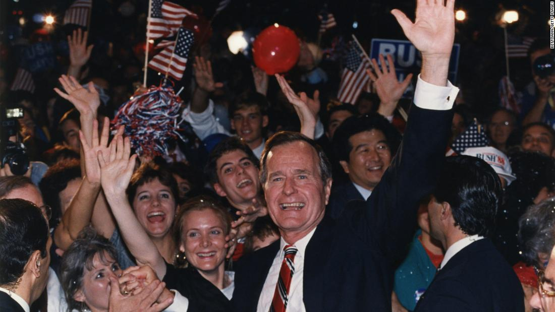 Bush joins supporters in Houston in November 1988 after learning he had defeated Dukakis in the presidential election.