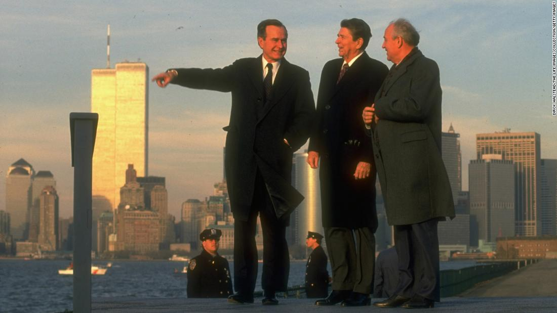 Soviet leader Mikhail Gorbachev takes in the New York skyline with Reagan and Bush in 1988.