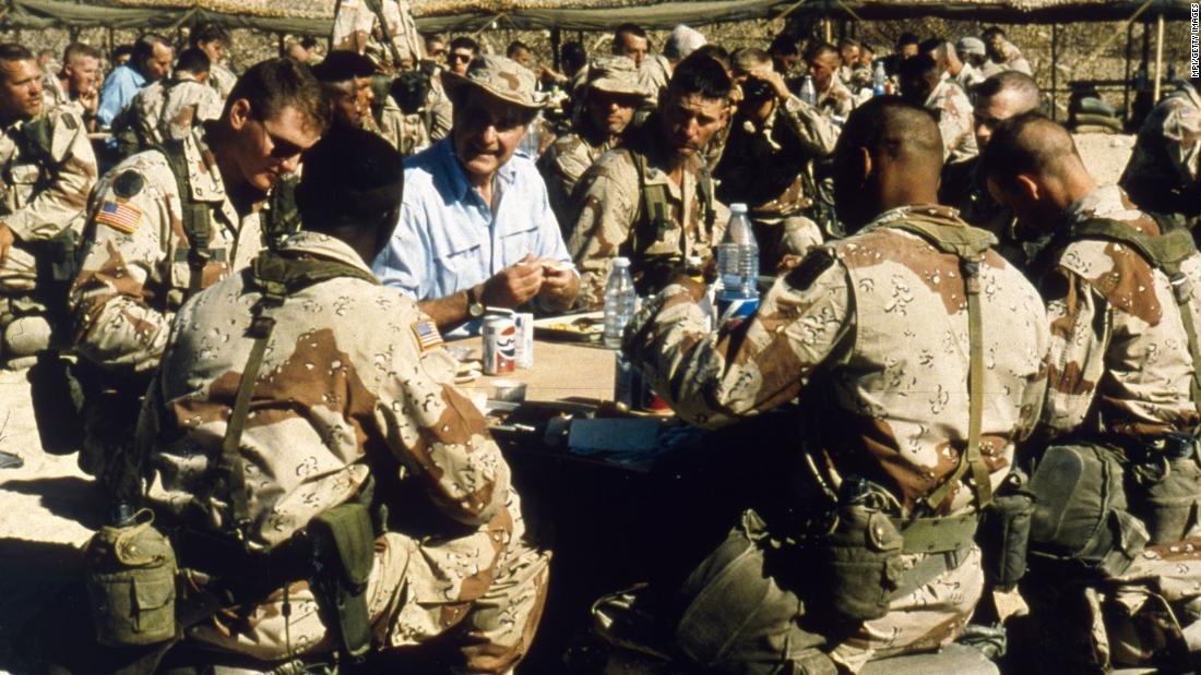 Bush visits American troops in Saudi Arabia on Thanksgiving Day in 1990. Operation Desert Shield was a coalition response to Iraq's invasion of Kuwait. It became Desert Storm in January 1991, when the coalition liberated Kuwait.