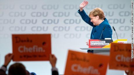 German Chancellor Angela Merkel reacts after her last speech as CDU leader.