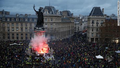Protesters gather in the Place de la Republique on December 8.