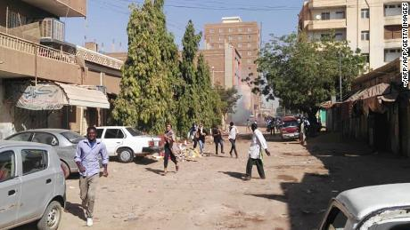 Sudanese protesters run away from tear gas during a demonstration in Khartoum on Monday.