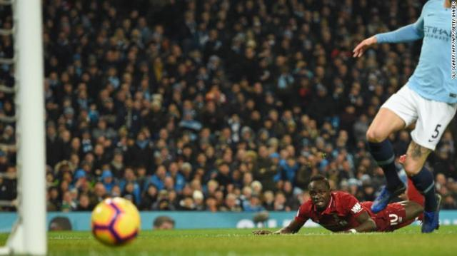 Sadio Mane goes fractionally close to giving Liverpool an early lead.