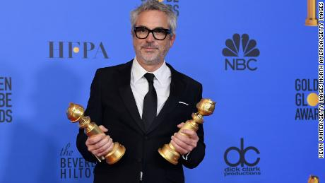 Alfonso Cuarón poses poses in the press room during the 76th Annual Golden Globe Awards