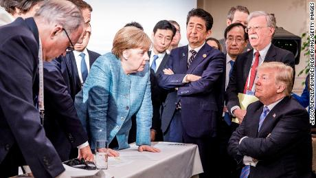 """After a rancorous G7 summit in 2018 in Canada and a """"somewhat depressing"""" outcome, Merkel's office released this photo."""