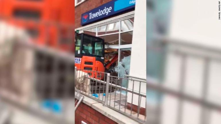 An image taken from the video showing the digger going through the front of the hotel.
