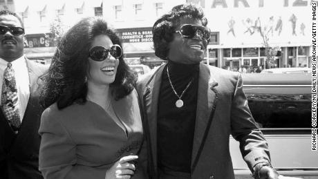 James Brown and wife Adrienne promote his new line of cookies.