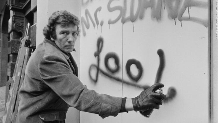 English actor Albert Finney writing on a wall with a spray can, UK, 3rd March 1975. He is directing a revival of the play 'Loot' as part of the Joe Orton Festival at the Royal Court Theatre. (Photo by Evening Standard/Hulton Archive/Getty Images)