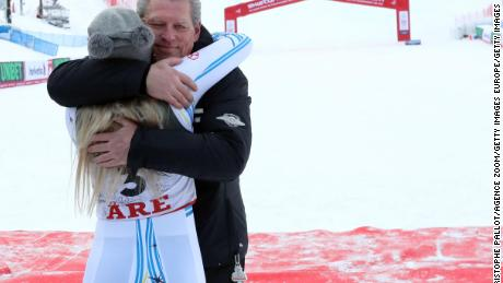 Vonn hugs her father at the finish line.